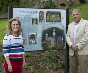 Susan Petrick and Steve Willing admire the St. Nicholas Church Interpretive Panel.