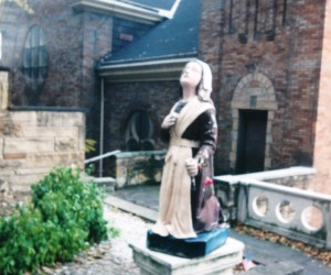 St. Bernadette gazing up at the Blessed Mother