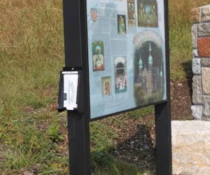 Brochure box and church interpretive panel