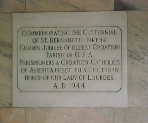 Dedication plaque inside the grotto chapel