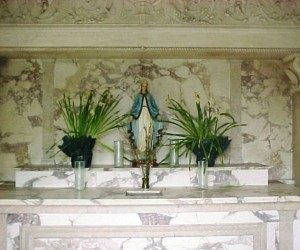 Marble altar inside grotto chapel donated by Mrs. John Crnkovic in memory of her son, Walter, who died in WWII