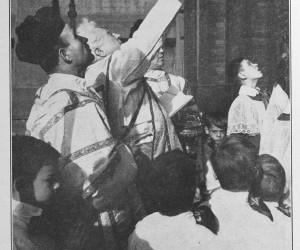1939 Fr. Bekevac blessing the plaque over the front church entrance