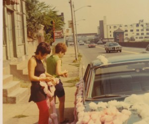 1970 Decorating cars with carnations for a wedding. Marohnic Book Store on left