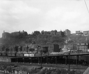 1920 - View of E. Ohio St. from Herr's Island showing Heinz rail cars & Island Hotel  715.205875.CP **