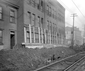 1920 - View of men raising 23in. cast iron line at 721 E. Ohio St. 715.205058.CP **